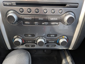 Climate controls. Yay knobs! But temperature and mode changes are displayed WAY up on the screen - so why are the controls buried in the bottom of the stack?