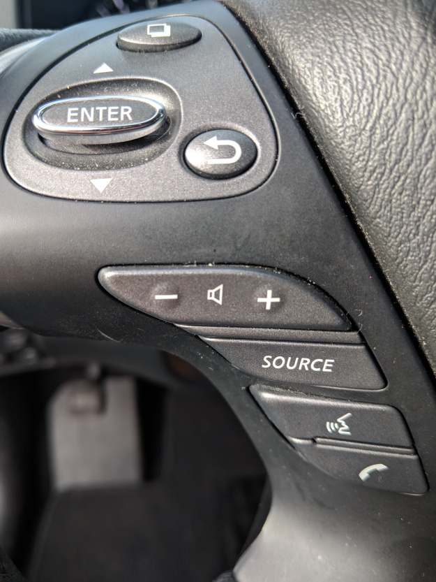 Button to switch between pages on the gauge cluster's multi-function display. The toggle switch and Enter button control the center stack's touch screen... for some reason.... Hey! THERE'S THE PHONE MENU BUTTON!
